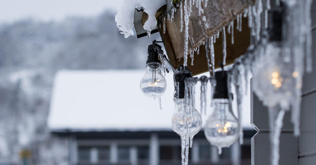 Edison bulbs strung on a home for sale